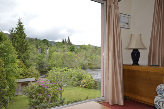 Lounge offering views to  garden and River Oich