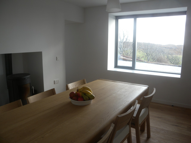 Dining room has a wood burning stove and lovely views