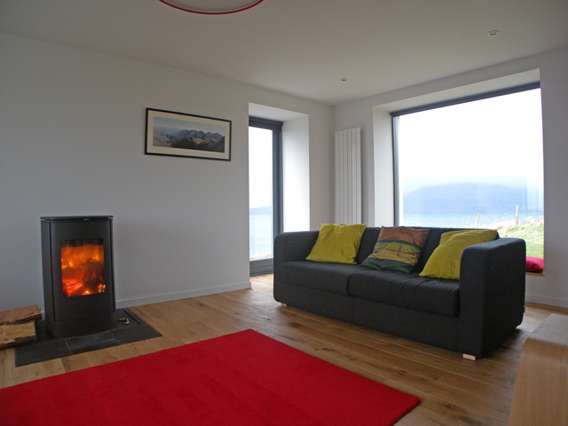 The lounge has stunning views and has a wood burning stove