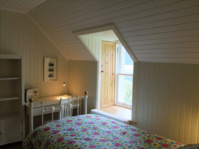 Twin bedroom showing window and shutters