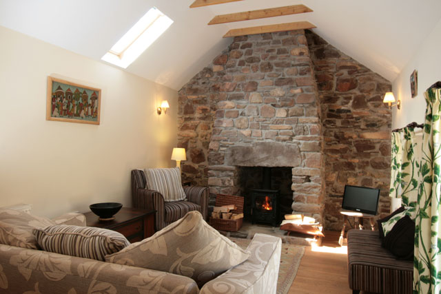 Lounge with feature stonework and woodburing stove
