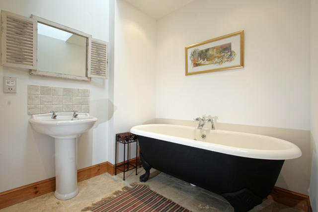 Bathroom with traditional roll top bath