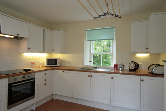 Well equipped kitchen with garden views