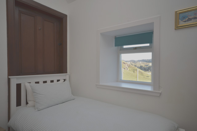 One of the twin bedrooms with sea views