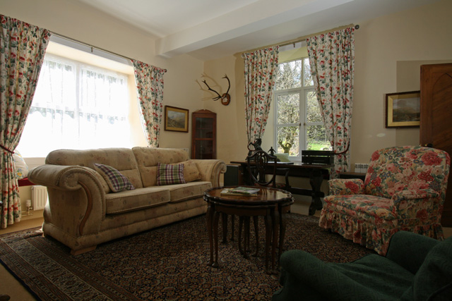 Sitting room has view over the garden and forest