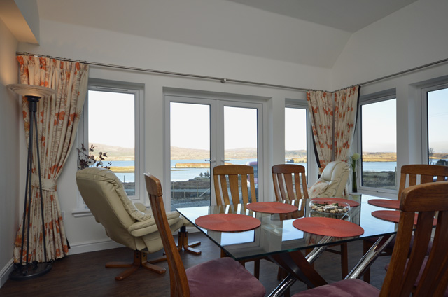 The dining room has a stunning view of the Cuillin and the loch