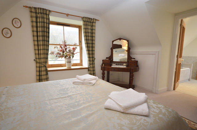 Upstairs bedroom with king size bed and en-suite bathroom