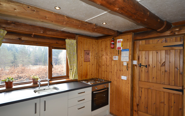 Kitchen has views over the woodland